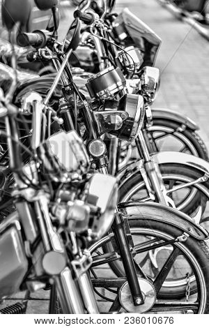 Riders Will Love. Cropped Shot Of The Wheels Of Motorbikes Standing In The Line At The Motorcycle Sa