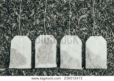 Paper Tea Bags On Dry Tea As Background