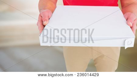 Delivery man lower body with pizza against blurry background
