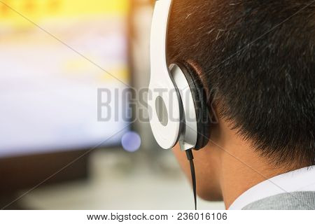 Education E-learning Foreign Languages Concept : Student Young Man Wearing Headphones Listening Engl