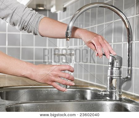 Filling A Glass Of Water