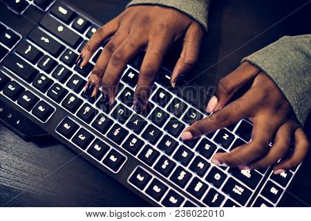 Closeup of hands working on computer keyboard