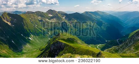 Panorama Of Fagarasan Mountain Ridge In Summertime. Lovely Landscape With Cliffs And Grassy Hills Ov