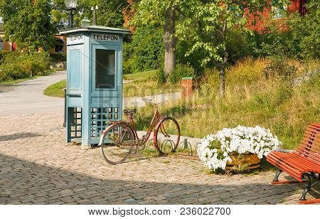 Old Phone Box And Bicycle At Skansen, The First Open-air Museum And Zoo, Located On The Island Djurg