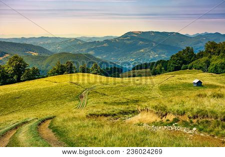 Truck Path Down The Grassy Hill. Wooden Shed On The Hillside. Beautiful Landscape With Krasna Mounta