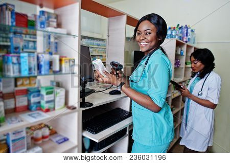 Two African American Pharmacist Working In Drugstore At Hospital Pharmacy. African Healthcare.