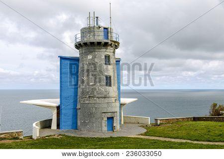 lighthouse at Matxitxako, Cape Bermeo, Vizcaya, Basque Country, Spain. bird watcher poster