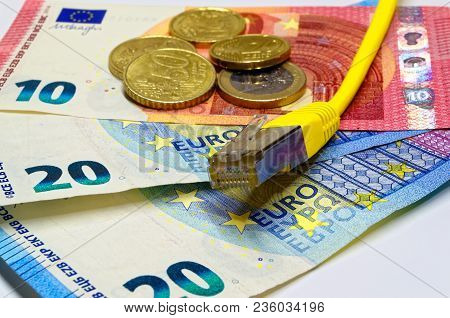 Yellow Ethernet Network Connection Plug Lying On Euro Banknotes