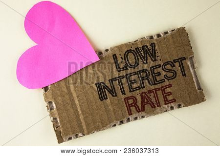 Handwriting Text Low Interest Rate. Concept Meaning Manage Money Wisely Pay Lesser Rates Save Higher