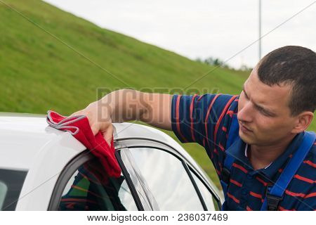 Man Is Wiping A Car With A Rag, Close-up