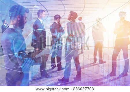 Businesspeople In Abstract Interior With Blurry Forex Chart. Meeting, Stock, Trade, Teamwork And Pro