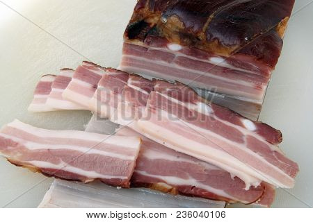 Smoked bacon meat. Dry and smoked bacon. Smoked bacon slices.