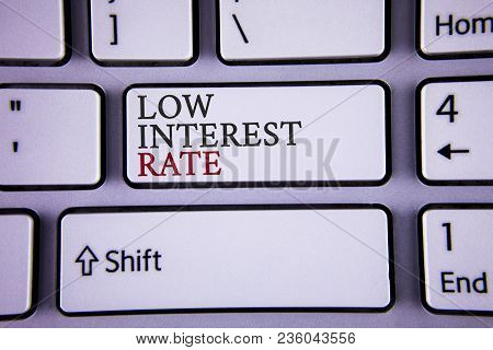 Handwriting Text Writing Low Interest Rate. Concept Meaning Manage Money Wisely Pay Lesser Rates Sav