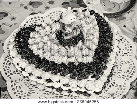 Big Birthday Chocolate And Foam Cake With Sugar Pig. Symbolic Food. Feast Table. Black And White Pho