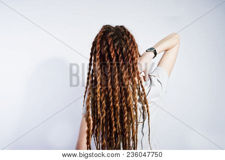 Studio Shoot Back Of Girl In Gray Dress With Dreads On White Background.