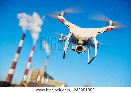 security and safety. drone flying near power plant.