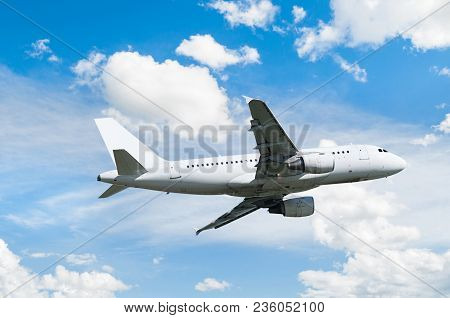 Aircraft Flying In The Sky, Travel Background With Commercial Flying Aircraft With Blank Livery. Air