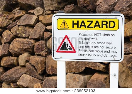 Do Not Climb On The Rocks Warning Sign