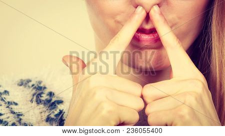 Stinky Smells, Clogged Concept. Nerdy Woman Holding Nose Because Of Bad Scent