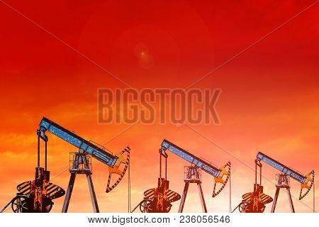 Oil Pumps At Sunset. Oil Field At Sunset.