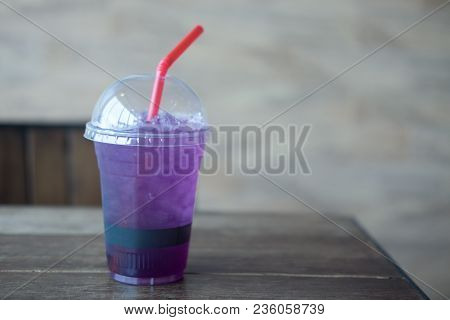 Ice Purple Butterfly Pea Flower Tea On Wood Table