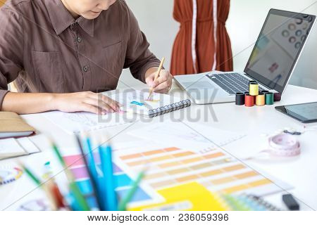 Stylish Fashion Designer Working As Fashion Designers Measure As Sketches In Her Workshop Of New Col