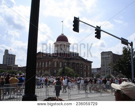 People Attending A Barack Obama Campaign Rally With The Old State Capitol Building In The Background