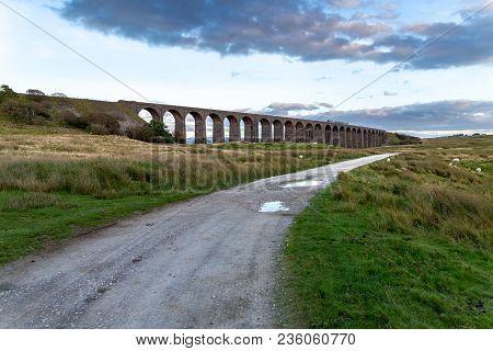 Near Ingleton, North Yorkshire, England, Uk - September 11, 2016: A Train Passing The Ribblehead Via