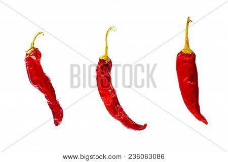 Three Red Hot Peppers Isolated On White Background