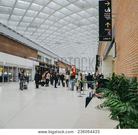 Venice, Italy On 28th Mar 2018: Passengers At The Modern Interior Of Marco Polo International Airpor
