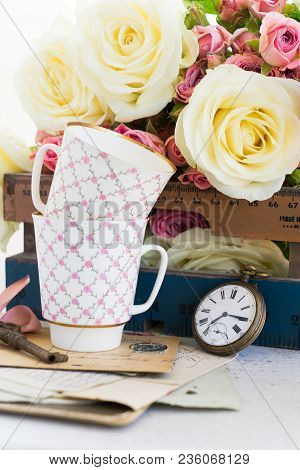 Pink And White Blooming Roses With Two Cofee Cups