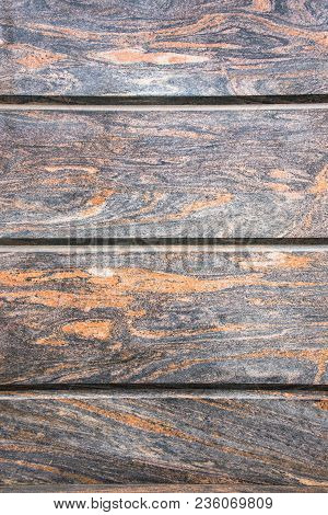 Decorative Facing, Made Of A Gray Polished Stone Plates With A Natural Fancy Ornament Like A Randoml