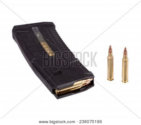 Bulletes And High Capacity Magazine That Goes Into A Modern Assault Rifle.