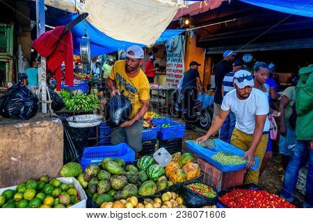Higuey, Dominican Republic - November 1, 2015: Two Unidentified Men Selling Fruit In Local Market In