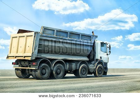 Big Dump Truck Goes On Highway Clouse Up Photo