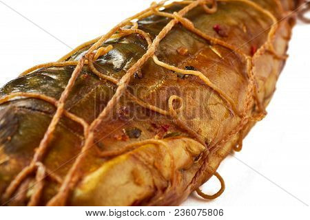 Mackerel Smoked Spices, Bound With Thread Isolated On White Background.