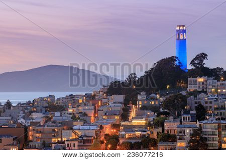 Coit Tower On Telegraph Hills And San Francisco Bay With Angel Island In The Background At Dusk. Tak