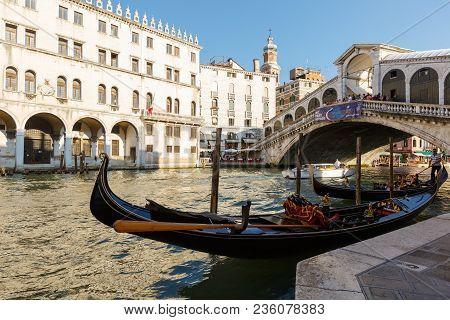 Venice, Italy - June, 21, 2013: View Of Gondola And Ponte Di Rialto, Many Tourists On A Bridge, Moto