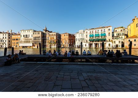 Venice, Italy - June, 21, 2013: Evening On The Grand Canal. Silhouettes Of A Lot Of People Admiring