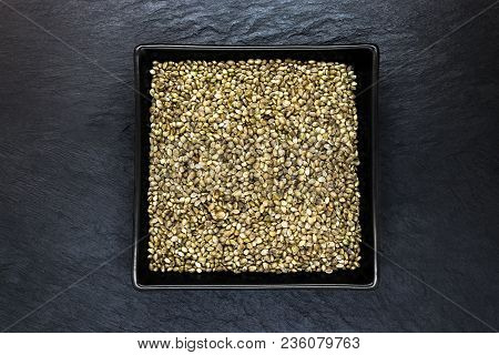 Very Sharp And Clear Cannabis Seeds In Black Plate On Black Stone Background Surface