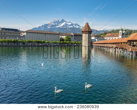 Springtime View In The City Of Lucerne, Switzerland: The Reuss River And Buildings Along It, Water T