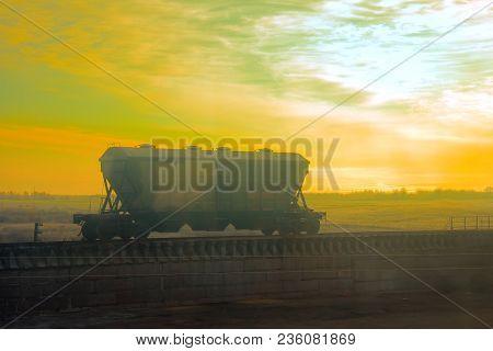 Self Unloading Cargo Wagon To Transport Bulk Cargo (ballast Hopper Car; Hopper-batcher) On Backgroun