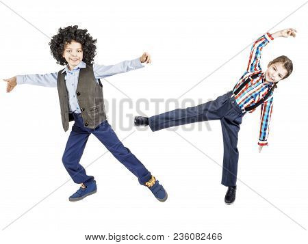 Collage. A Happy Boy In A Blatz Afro Wig And A Black Waistcoat Is Dancing. Isolated. White Backgroun