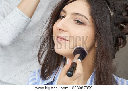 Master Inflicts Brush Powder On The Face Of The Girl, Completes The Day Make-up In A Beauty Salon. P