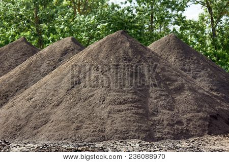 Heaps Of Sand Brought By Truck. Construction Of Roads. Preparing Sand Bags For Asphalt, Sand Blanket