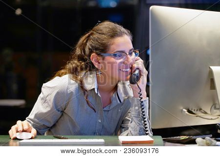 Hotel Administrator. A Woman-reception Worker Accepts An Order For Booking A Room By Phone. Profile