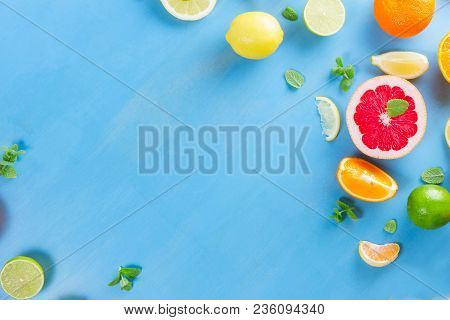Citrus Food Flat Lay Frame Pattern On Blue Background With Copy Space - Assorted Citrus Fruits With