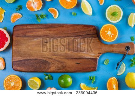 Citrus Food Pattern On Blue Background - Assorted Citrus Fruits With Mint Leaves, Copy Space On Cutt