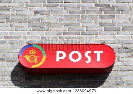 Steensballe, Denmark - April 2, 2018: Danish Post Logo On A Wall. Danish Post Called Post Danmark In