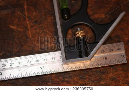 Close Up Of An Imperial System Ruler With Tool For Right Angles